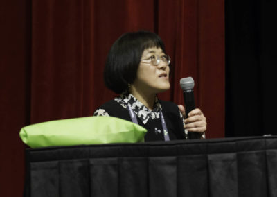 Dr. Young Ko participates in the discussion.