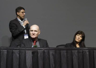 Dr. Khan asks questions of the panel about how to improve conventional chemotherapy standards of care.