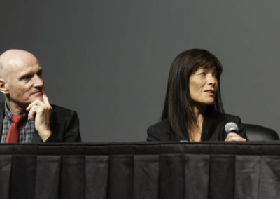 Dr. Bagot and Dr. Taguchi engage in the discussion.