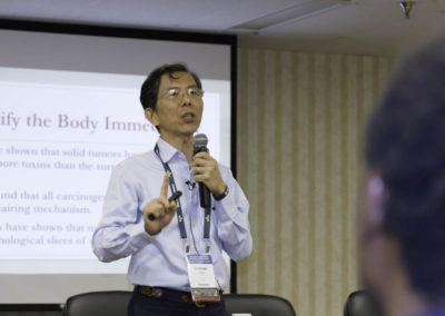 Dr. Lichuan Chen, PhD presenting about integrative cancer therapy.
