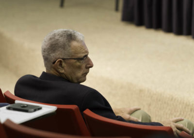 Dr. Thomas Seyfried listening to another lecture on cancer metabolism.