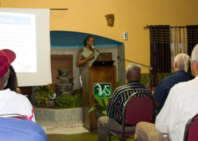 "Uchenna Hackett (""Dr. Livet"") presenting at the conference"
