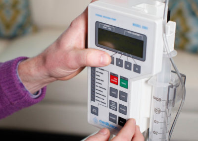 Dr. Andrews programs a computerized infusion pump